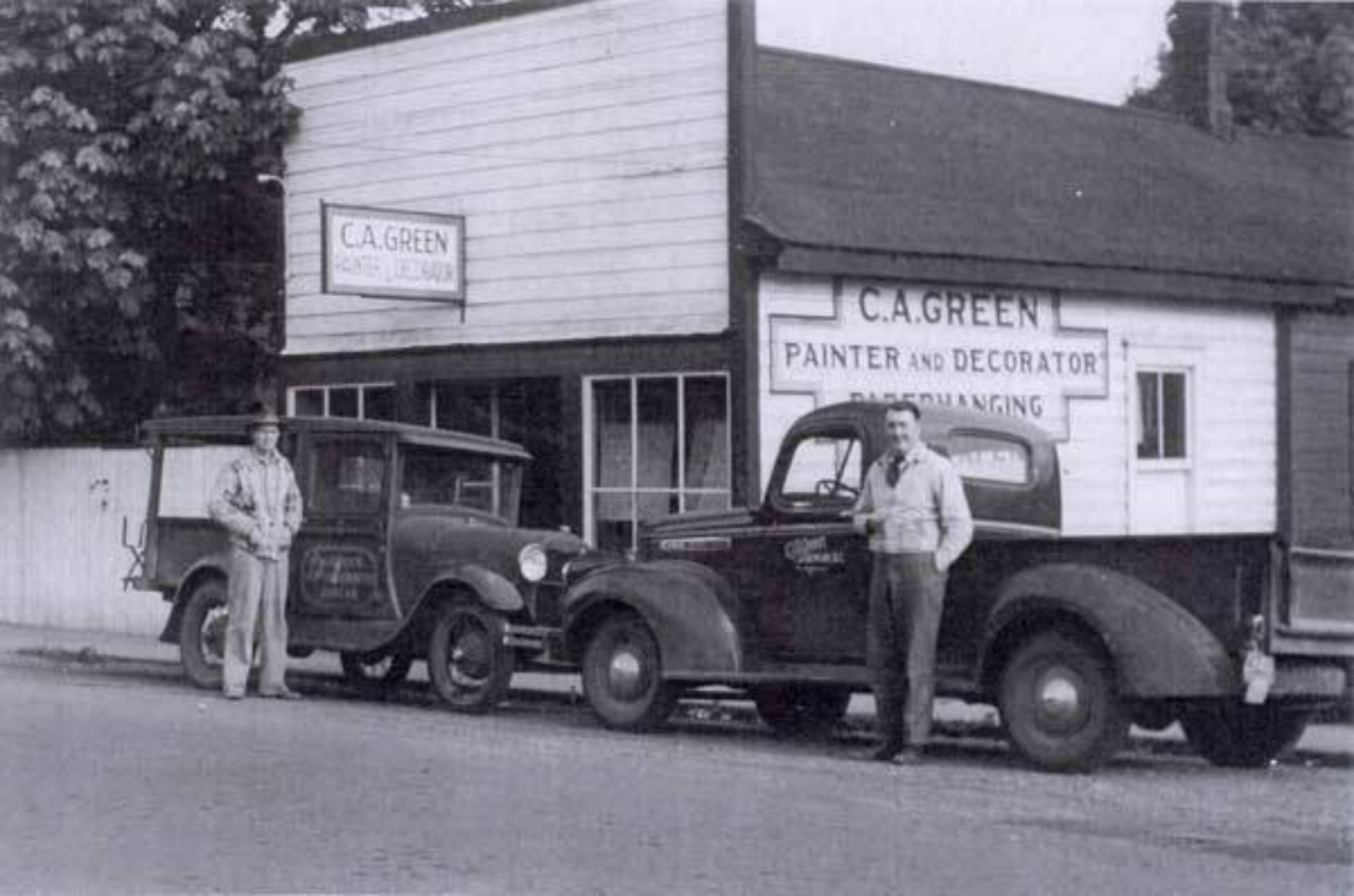 Claude Green (right) in front of his business building at 161 Kenneth Street, circa 1940. The sign on the exterior wall behind Claude Green is still visible on 161 Kenneth Street today