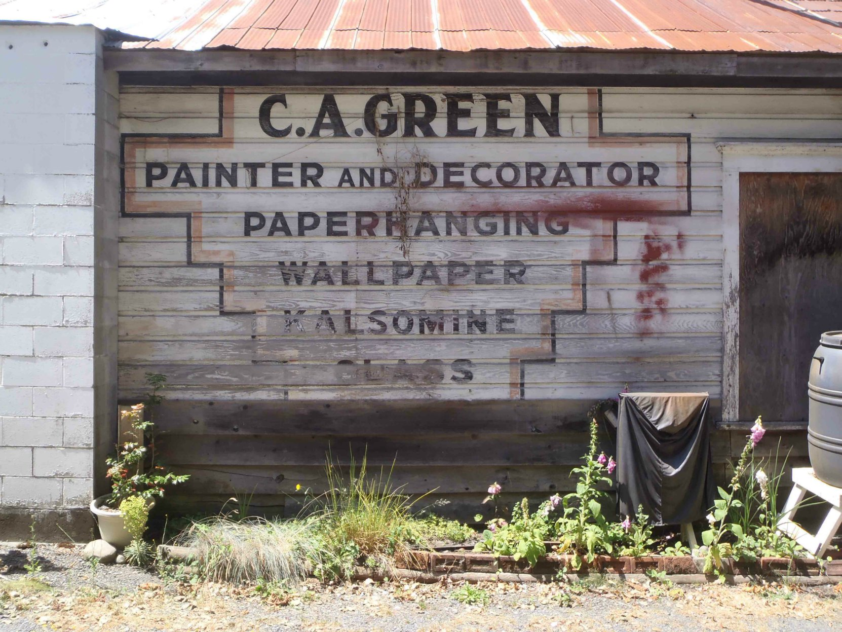 Claude Green business sign, circa 1940, is still visible on 161 Kenneth Street in downtown Duncan