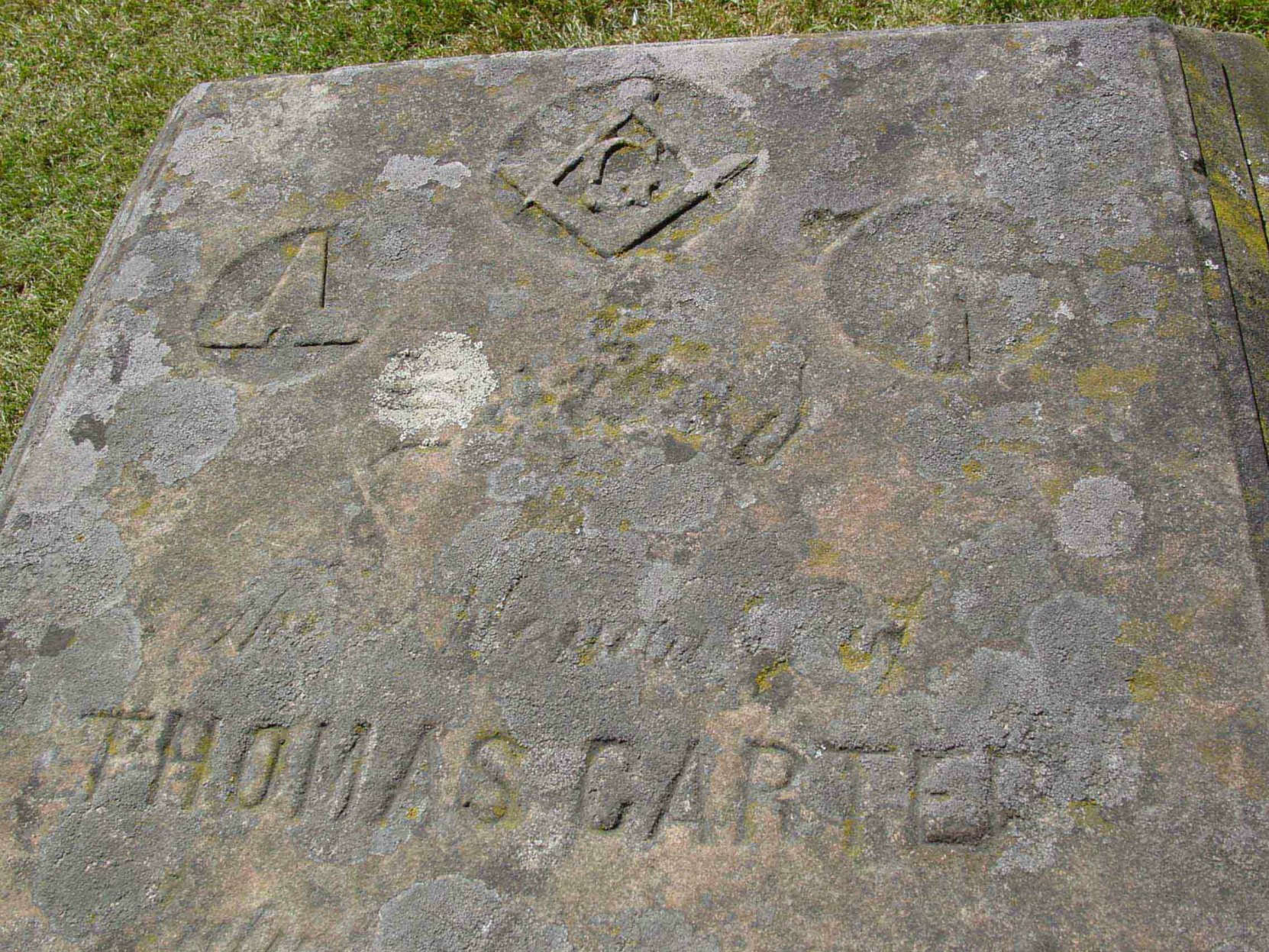 Masonic imagery, the Square & Compasses, the Level and the Plumb, on the Thomas Carter grave marker, Pioneer Square, Victoria, B.C.