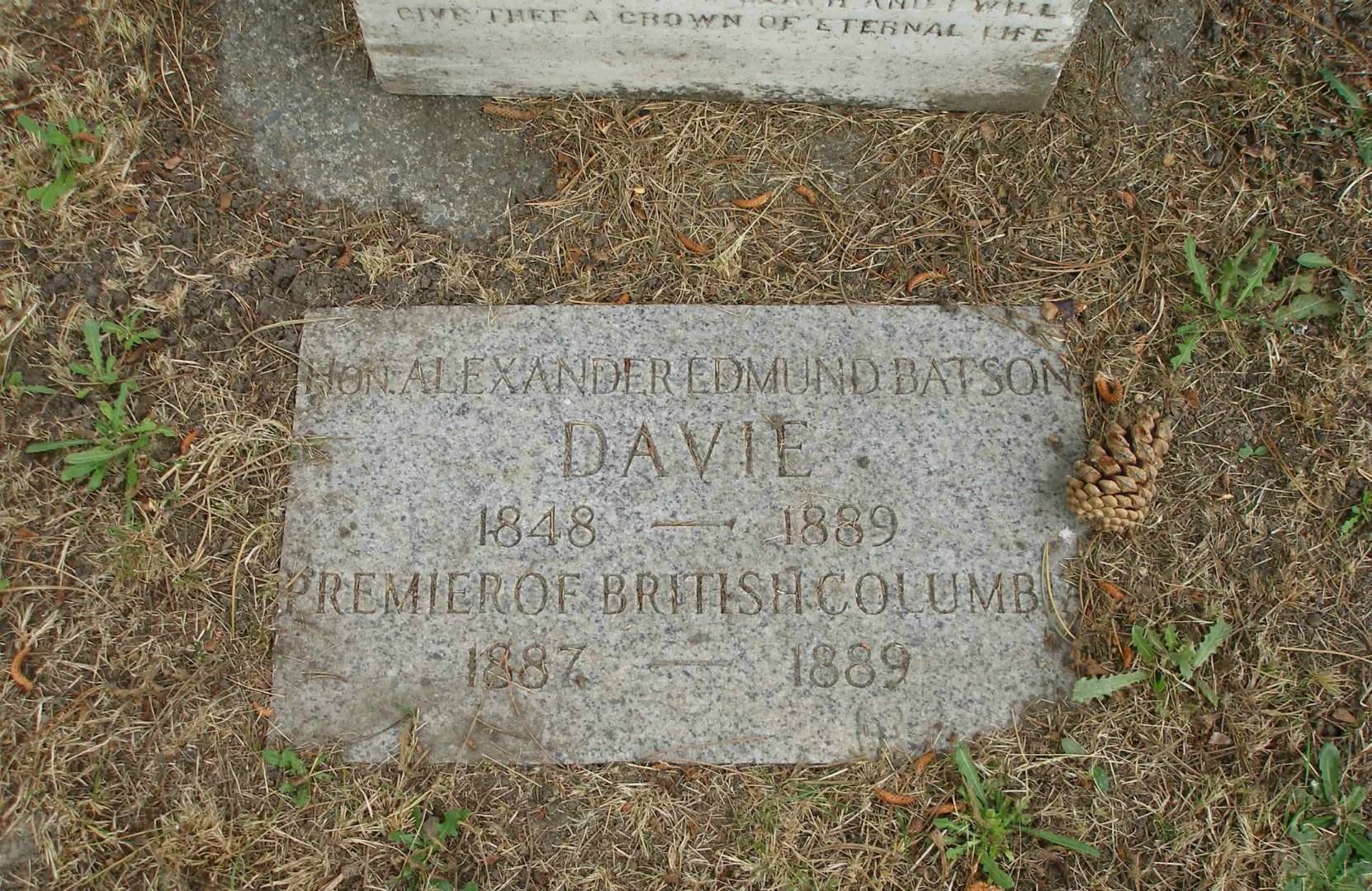 This newer grave marker has been placed in the ground at the base of Alexander Davie's original grave marker.
