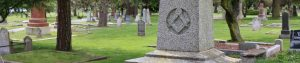 web header photo showing Masonic Square & Compasses on a gravestone in Ross Bay Cemetery