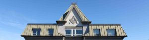 web header image showing the roofline of a Victoria building displaying a Masonic Square & Compasses