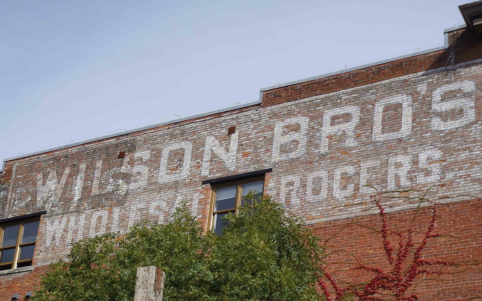 532 Herald Street, built in 1908-1909 as a warehouse for Wilson Brothers. The Wilson Brothers sign is still visible on the west side of the building.