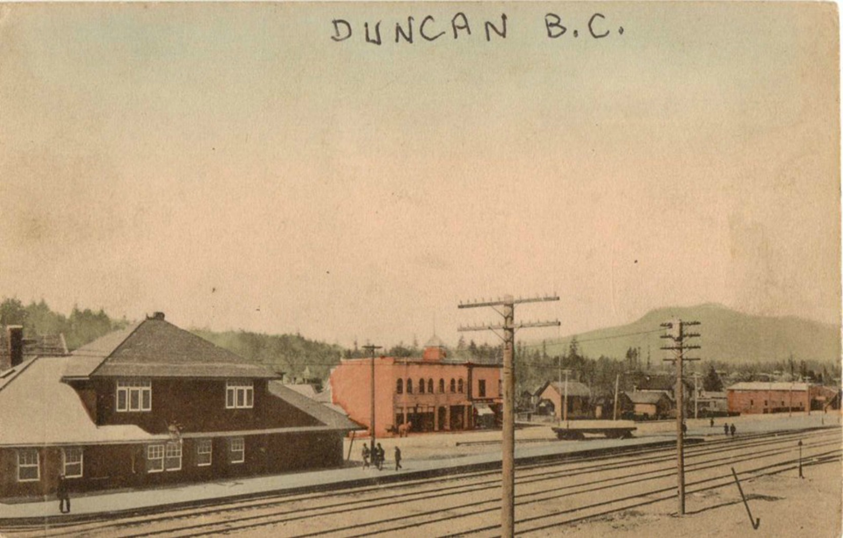 The E&N Railway Station (left) and the Duncan Masonic Temple (center) circa 1913-1914