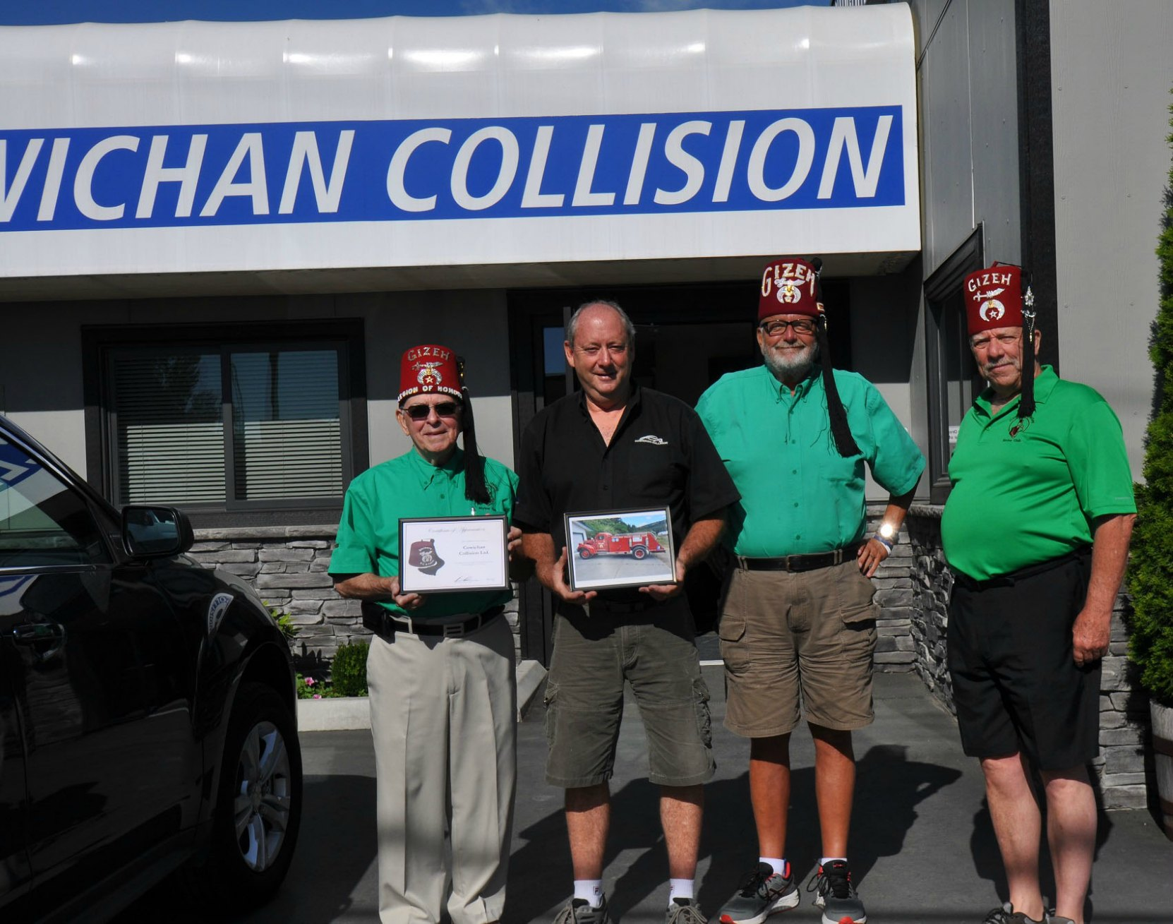 Cowichan valley Shrine Club members Brian Nicol, Tom Mitchell and Pat Ffyfe present Certificate of Appreciation to Ron Mellson, owner of Cowichan Collision, Duncan, B.C. on 26 July 2017 (photo by Cowichan Valley Shrine Club)