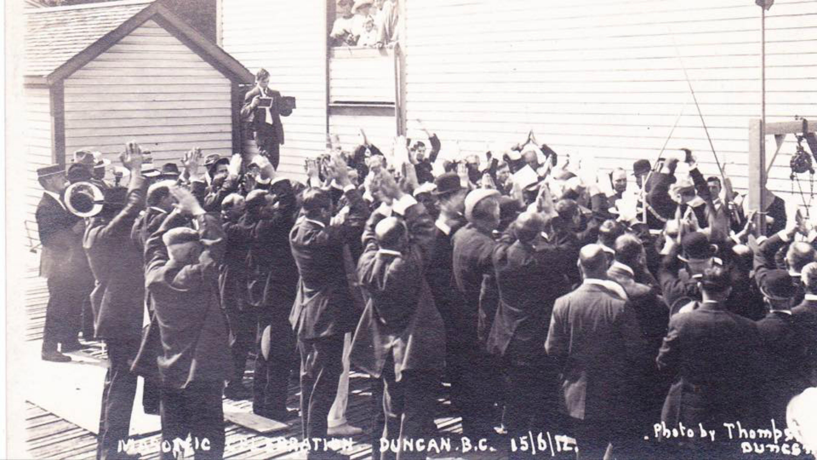 Corner Stone Ceremony for the present day Duncan Masonic Temple, 15 June 1912. Mrs. Norcross' chicken coop is visible in the left rear.