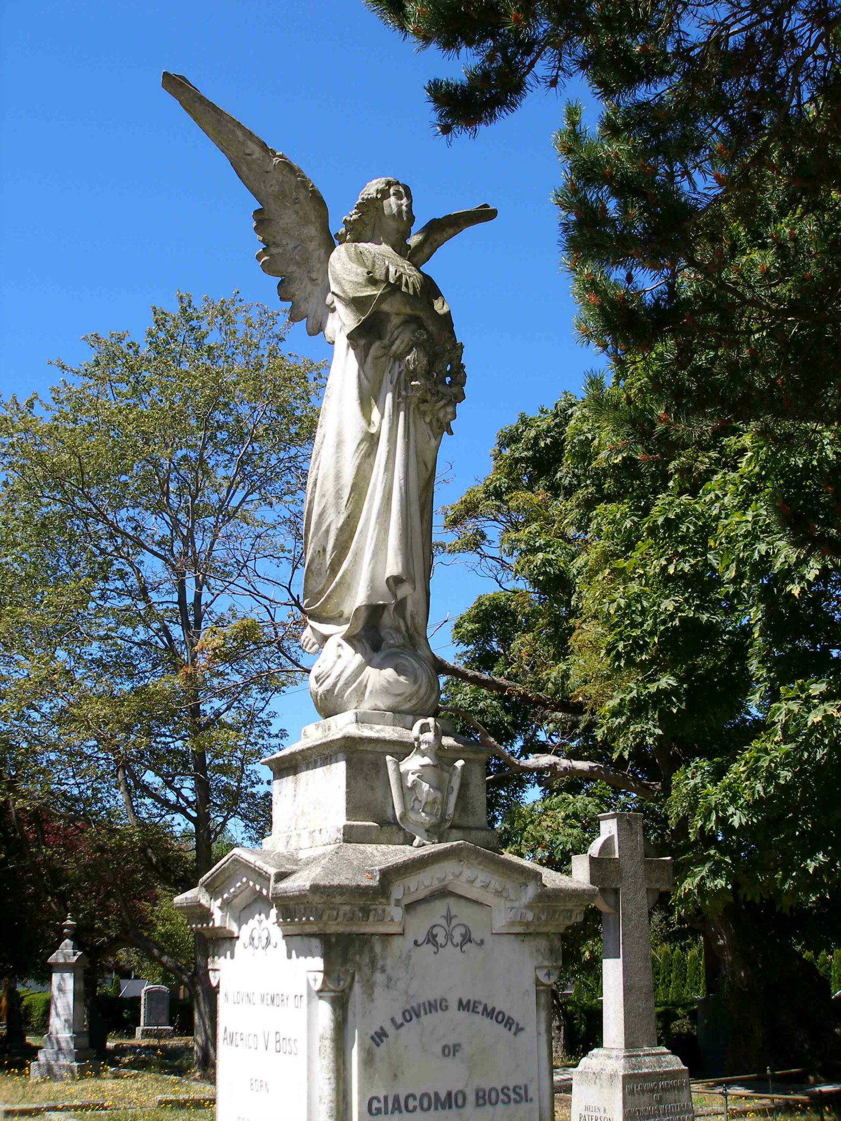 "The angel figure on the Giacomo Bossi grave, Ross Bay Cemetery, Victoria, B.C. The ""Bossi Angel"" is one of the most photographed grave markers in Ross Bay Cemetery. (photo by Temple Lodge No. 33 Historian)"
