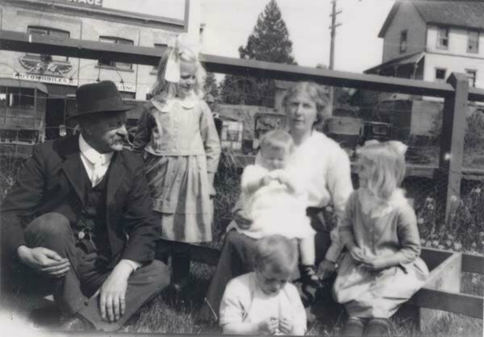 Roland Clayton Fawcett and his family outside the E&N Station, Duncan, 1922. The Duncan Garage is in the left background. The building on the right background is the Alderlea Hotel(now demolished) once owned by Charles Herbert Dickie. (Photo: Cowichan Valley Museum & Archives)