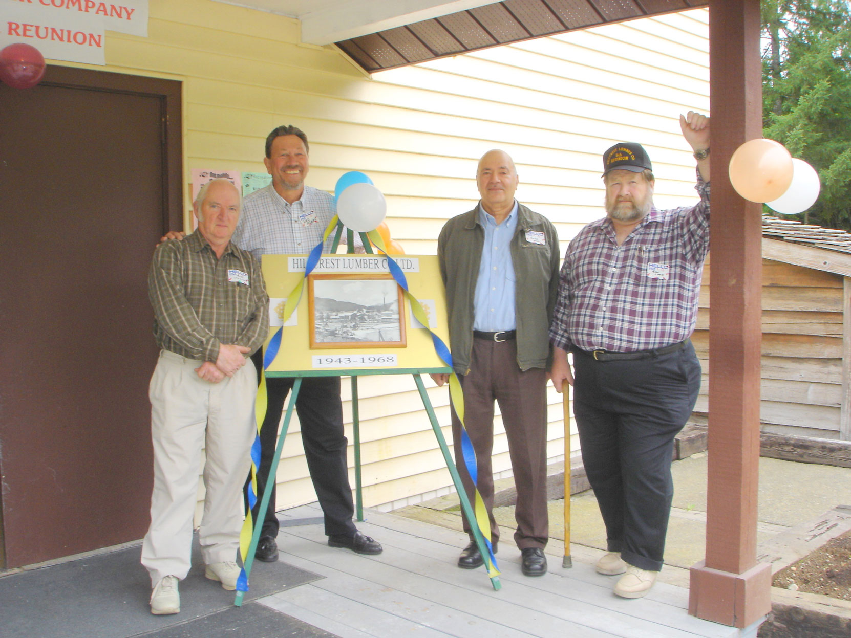 Bob Crawford (left), Cecil Ashley and others at the Hillcrest Lumber Co. Employees Reunion in 2006. (photo courtesy of Cecil Ashley)
