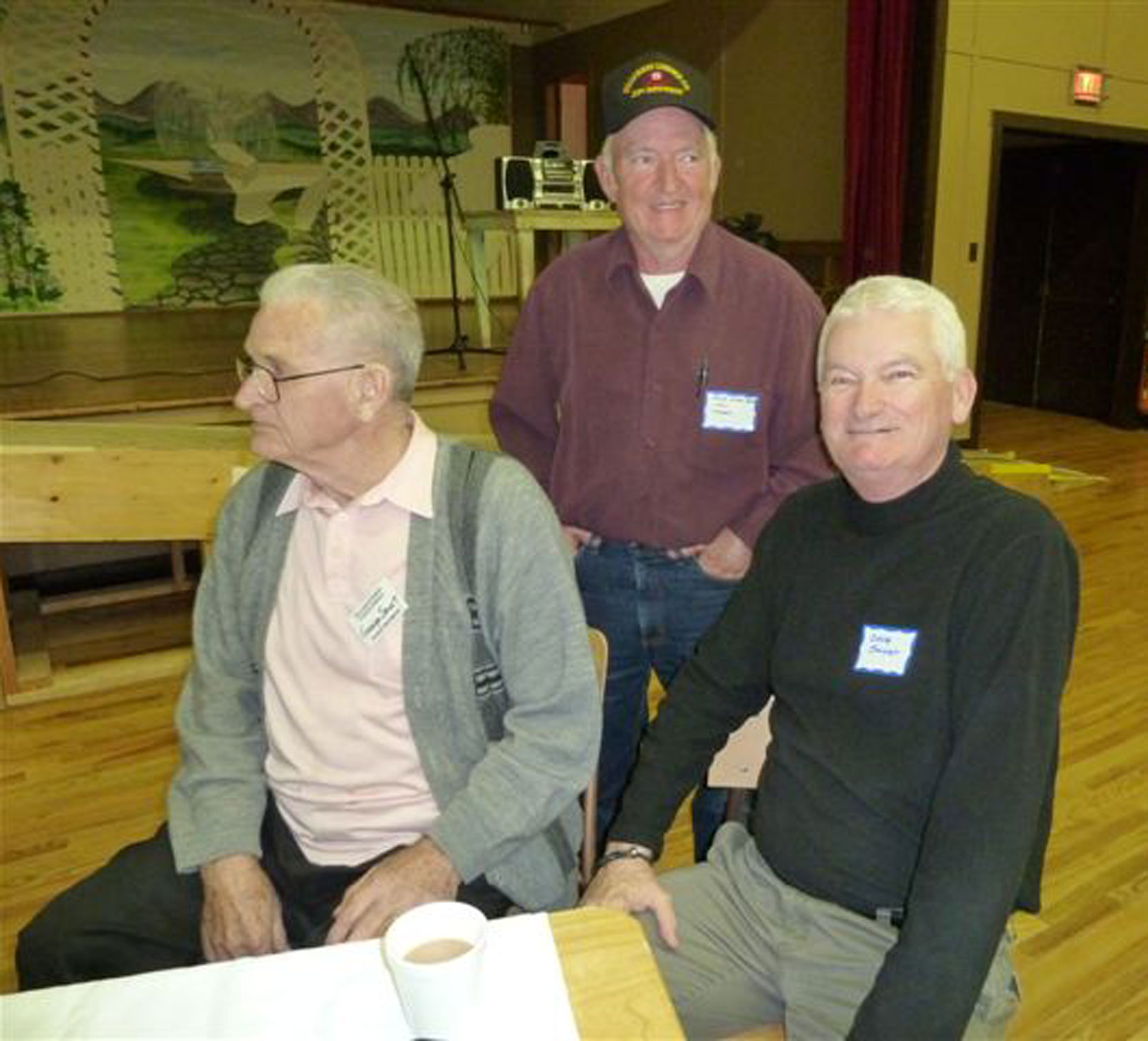 Bob Crawford (standing) at Hillcrest Lumber Company Employees Reunion, 2009. SEated left is George Smart, Woods manager for Hillcrest Lumber Company and Bob's boss when Bob was at Hillcrest. Seated right is George Smart's son Doug Smart. (photo: Cecil Ashley)