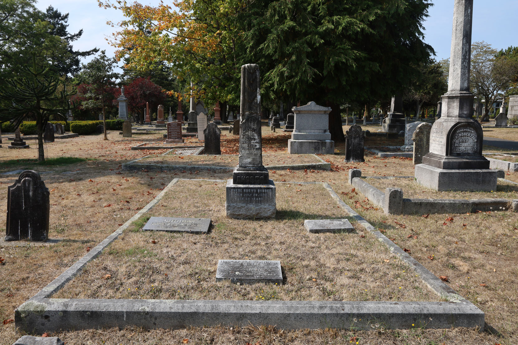 George Anthony Walkem gravestone (foreground) in the Rhodes family plot, Ross Bay Cemetery, Victoria, BC (photo: Temple Lodge No. 33 Historian)