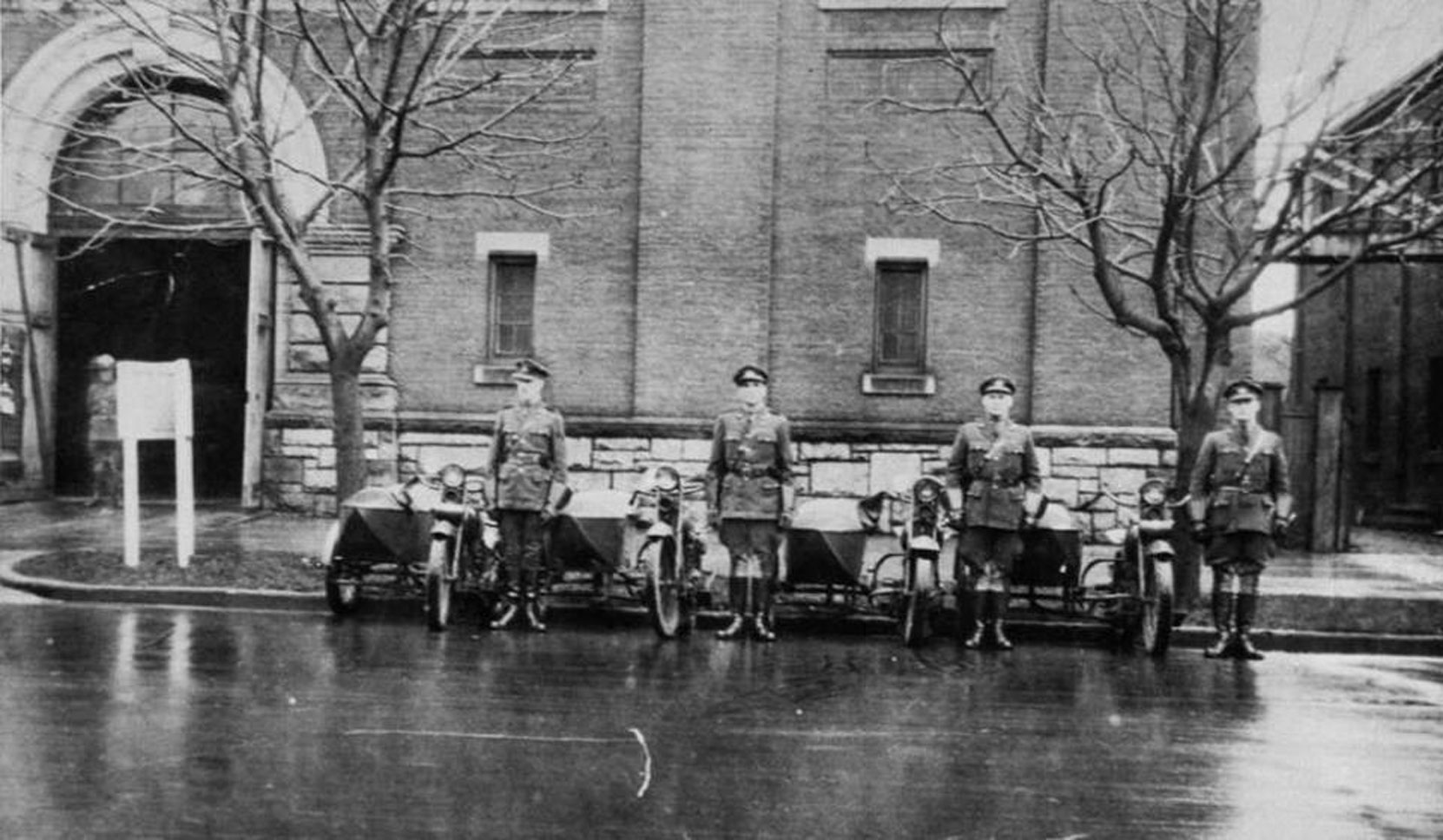William Percy Aylward (left) with other members of the B.C. Provincial Police motorcycle squad in front of former drill Hall on Menzies Street in Victoria, circa 1926 (photo courtesy of Rick Aylward, used with permission)