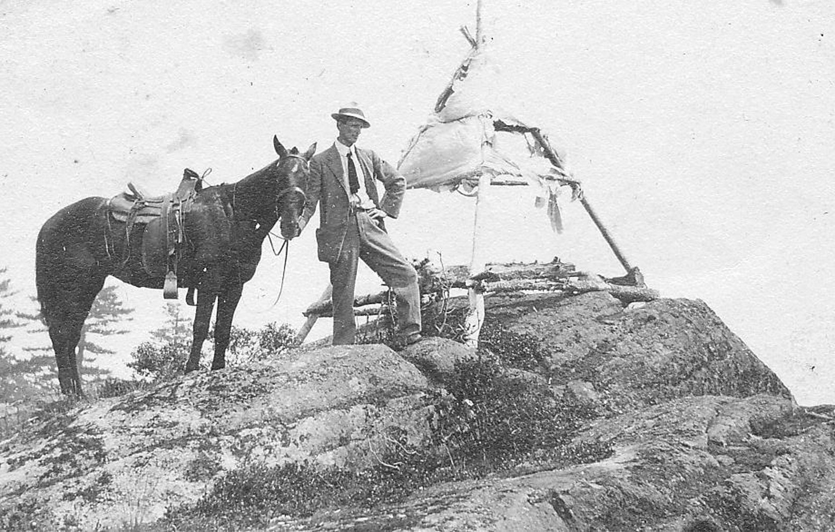 Ormond Towers Smythe on Mt. Prevost, circa 1920. The tent is for the surveyors' pin that is still on the west hump of Mt. Prevost. (photo courtesy of Larry Kier - private collection)